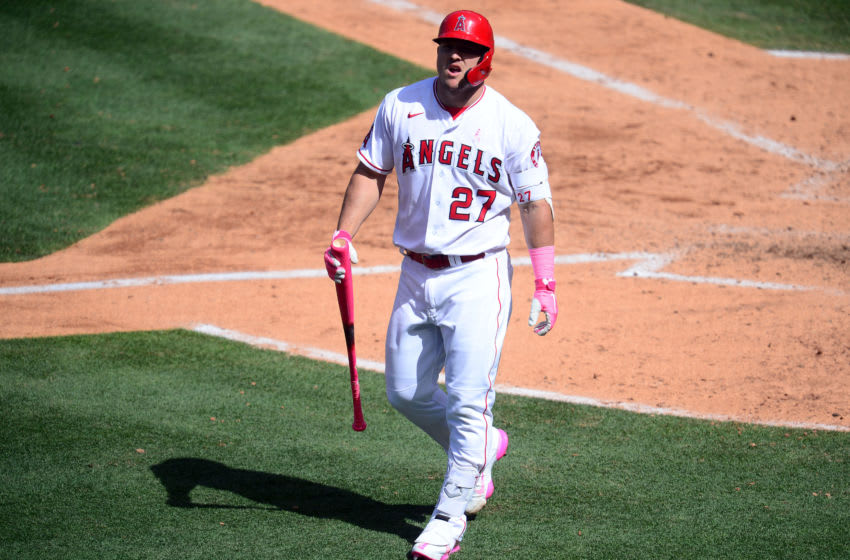 May 9, 2021; Anaheim, California, USA; Los Angeles Angels center fielder Mike Trout (27) reacts after striking out against the Los Angeles Dodgers during the sixth inning at Angel Stadium. Mandatory Credit: Gary A. Vasquez-USA TODAY Sports