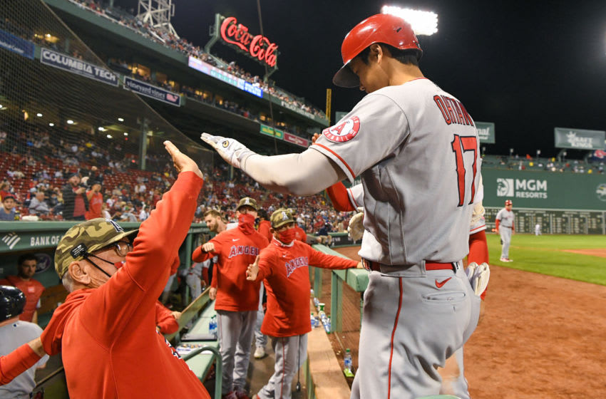 May 14, 2021; Boston, Massachusetts, USA; Los Angeles Angels designated hitter Shohei Ohtani (17) high-fives manager Joe Maddon (70) after hitting a solo home run against the Boston Red Sox during the sixth inning at Fenway Park. Mandatory Credit: Brian Fluharty-USA TODAY Sports