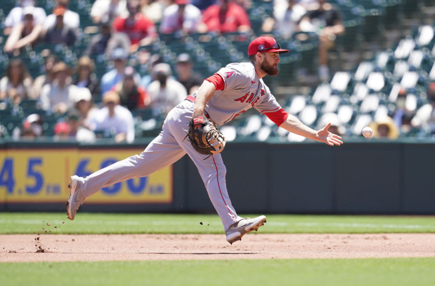 Los Angeles Angels infielder Jared Walsh (20) flips the ball to first to record an out against the San Francisco Giants in the first inning. Mandatory Credit: Cary Edmondson-USA TODAY Sports
