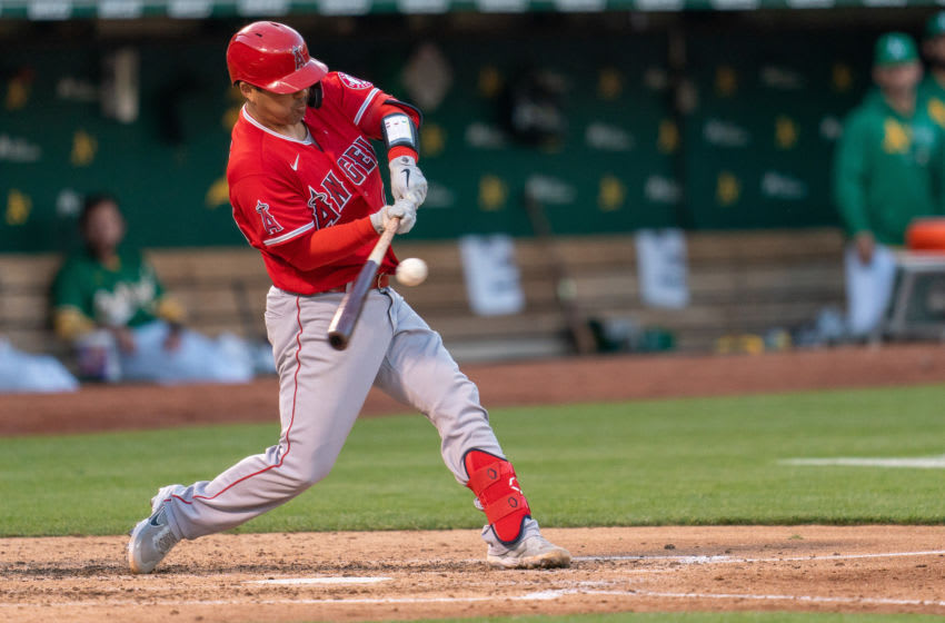 Los Angeles Angels catcher Kurt Suzuki (24) singles in the fifth inning against the Oakland Athletics. Mandatory Credit: Neville E. Guard-USA TODAY Sports