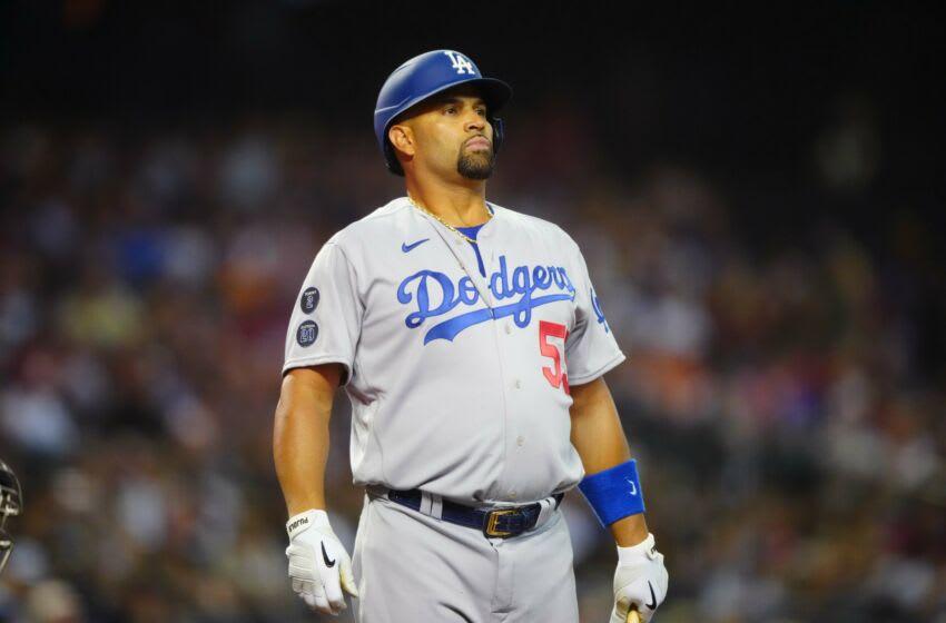Jun 18, 2021; Phoenix, Arizona, USA; Los Angeles Dodgers first baseman Albert Pujols in the first inning against the Arizona Diamondbacks at Chase Field. Mandatory Credit: Mark J. Rebilas-USA TODAY Sports
