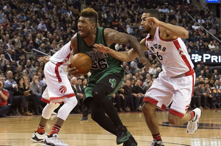 Jan 20, 2016; Toronto, Ontario, CAN; Boston Celtics guard Marcus Smart (36) drives to the basket as Toronto Raptors guard Cory Joseph (6) tries to defend during the fourth quarter in a game at Air Canada Centre. The Toronto Raptors won 115-109. Mandatory Credit: Nick Turchiaro-USA TODAY Sports