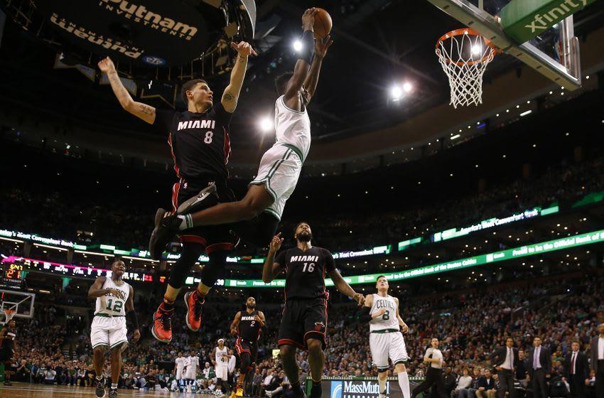 Dec 30, 2016; Boston, MA, USA; Boston Celtics forward Jaylen Brown (7) soars past Miami Heat guard Tyler Johnson (8) for a dunk during the second half at TD Garden. Mandatory Credit: Winslow Townson-USA TODAY Sports