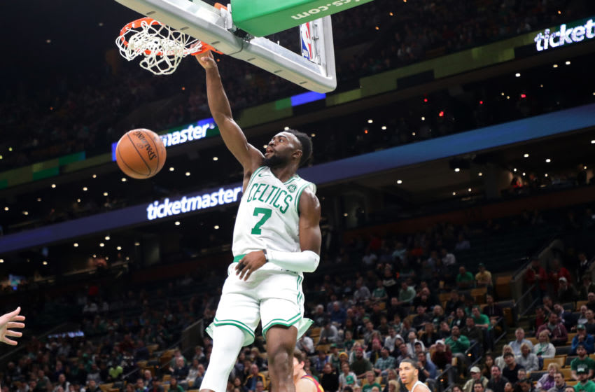 BOSTON - OCTOBER 2: Boston Celtics' Jaylen Brown slam dunks against the Cleveland Cavaliers during the first quarter. The Boston Celtics host the Cleveland Cavaliers in a preseason NBA basketball game at TD Garden in Boston on Oct. 2, 2018. (Photo by Matthew J. Lee/The Boston Globe via Getty Images)
