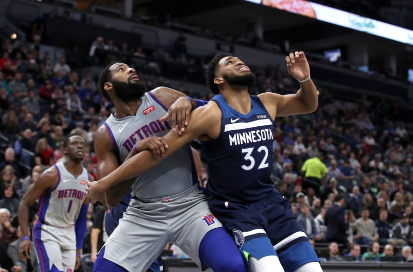 MINNEAPOLIS, MN - DECEMBER 19: Andre Drummond #0 of the Detroit Pistons and Karl-Anthony Towns #32 of the Minnesota Timberwolves fight for position during the game on December 19, 2018 at Target Center in Minneapolis, Minnesota. NOTE TO USER: User expressly acknowledges and agrees that, by downloading and/or using this photograph, user is consenting to the terms and conditions of the Getty Images License Agreement. Mandatory Copyright Notice: Copyright 2018 NBAE (Photo by Jordan Johnson/NBAE via Getty Images)