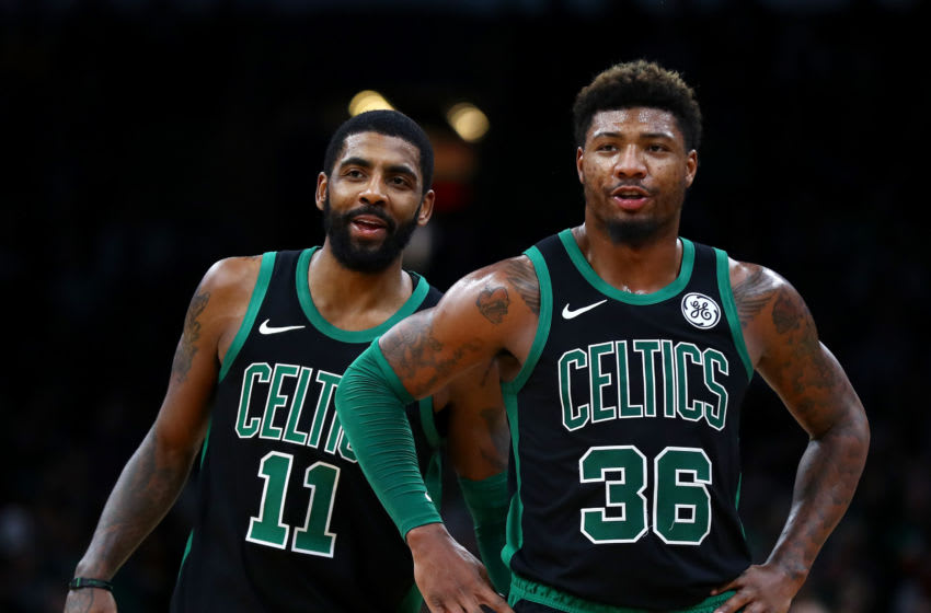 BOSTON, MASSACHUSETTS - DECEMBER 23: Kyrie Irving #11 and Marcus Smart #36 of the Boston Celtics react during the third quarter of the game against the Charlotte Hornets at TD Garden on December 23, 2018 in Boston, Massachusetts. NOTE TO USER: User expressly acknowledges and agrees that, by downloading and or using this photograph, User is consenting to the terms and conditions of the Getty Images License Agreement. (Photo by Omar Rawlings/Getty Images)