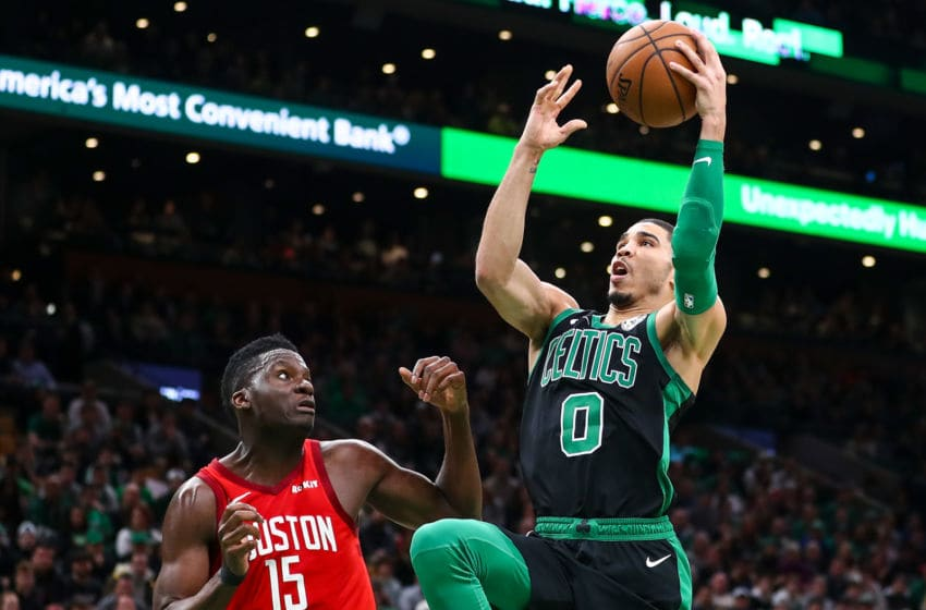 BOSTON, MA - MARCH 03: Jayson Tatum #0 of the Boston Celtics goes up for a layup over Clint Capela #15 of the Houston Rockets during a game at TD Garden on March 3, 2019 in Boston, Massachusetts. NOTE TO USER: User expressly acknowledges and agrees that, by downloading and or using this photograph, User is consenting to the terms and conditions of the Getty Images License Agreement. (Photo by Adam Glanzman/Getty Images)