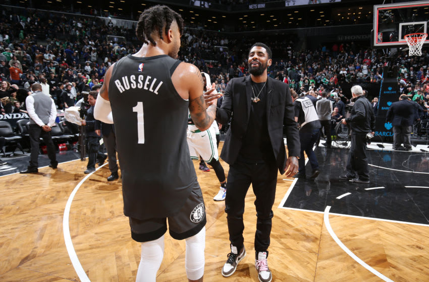 BROOKLYN, NY - MARCH 30: D'Angelo Russell #1 of the Brooklyn Nets and Kyrie Irving #11 of the Boston Celtics hug after the game on March 30, 2019 at Barclays Center in Brooklyn, New York. NOTE TO USER: User expressly acknowledges and agrees that, by downloading and or using this Photograph, user is consenting to the terms and conditions of the Getty Images License Agreement. Mandatory Copyright Notice: Copyright 2019 NBAE (Photo by Nathaniel S. Butler/NBAE via Getty Images)