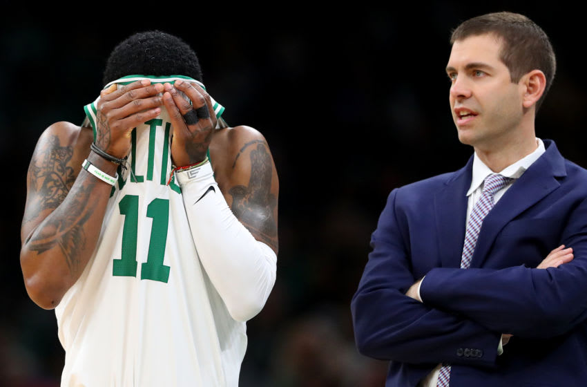 BOSTON, MASSACHUSETTS - APRIL 01: Kyrie Irving #11 of the Boston Celtics wipes his face next to the Celtics coach Brad Stevens during the second quarter at TD Garden on April 01, 2019 in Boston, Massachusetts. NOTE TO USER: User expressly acknowledges and agrees that, by downloading and or using this photograph, User is consenting to the terms and conditions of the Getty Images License Agreement. (Photo by Maddie Meyer/Getty Images)