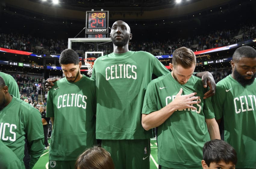 BOSTON, MA - OCTOBER 6: Enes Kanter #11 of the Boston Celtics, Tacko Fall #99 of the Boston Celtics, and Gordon Hayward #20 of the Boston Celtics stands for the national anthem before the game against the Charlotte Hornets on October 6, 2019 at the TD Garden in Boston, Massachusetts. NOTE TO USER: User expressly acknowledges and agrees that, by downloading and or using this photograph, User is consenting to the terms and conditions of the Getty Images License Agreement. Mandatory Copyright Notice: Copyright 2019 NBAE (Photo by Brian Babineau/NBAE via Getty Images)