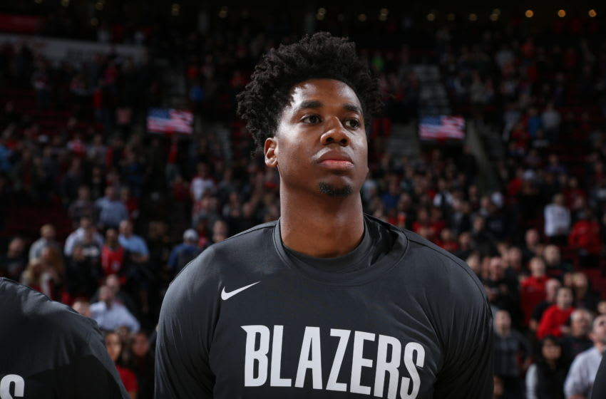 PORTLAND, OR - OCTOBER 12: Hassan Whiteside #21 of the Portland Trail Blazers stands for the National Anthem before a pre-season game against the Phoenix Suns on October 12, 2019 at the Moda Center in Portland, Oregon. NOTE TO USER: User expressly acknowledges and agrees that, by downloading and or using this Photograph, user is consenting to the terms and conditions of the Getty Images License Agreement. Mandatory Copyright Notice: Copyright 2019 NBAE (Photo by Sam Forencich/NBAE via Getty Images)