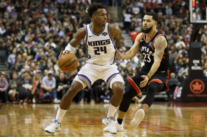 TORONTO, ON - NOVEMBER 06: Buddy Hield #24 of the Sacramento Kings is defended by Fred VanVleet #23 of the Toronto Raptors during first half of their NBA game at Scotiabank Arena on November 6, 2019 in Toronto, Canada. NOTE TO USER: User expressly acknowledges and agrees that, by downloading and or using this photograph, User is consenting to the terms and conditions of the Getty Images License Agreement. (Photo by Cole Burston/Getty Images)