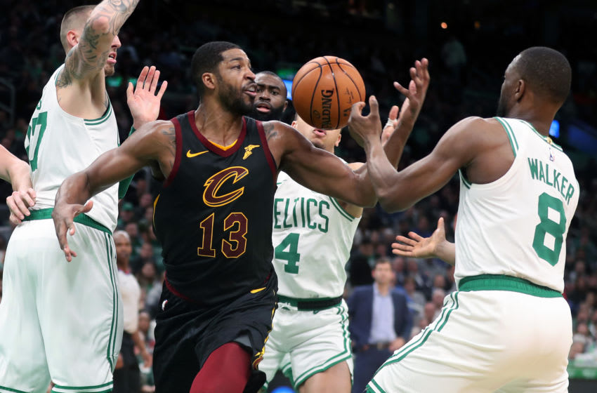 BOSTON - DECEMBER 9: Cleveland Cavaliers' Tristan Thompson (13) is surrounded by four Celtics, from left, Daniel Theis (27), Jaylen Brown, Carsen Edwards (4) and Kemba Walker (8) as he tries to control a first half rebound. The Boston Celtics host the Cleveland Cavaliers in a regular season NBA basketball game at TD Garden in Boston on Dec. 9, 2019. (Photo by Jim Davis/The Boston Globe via Getty Images)