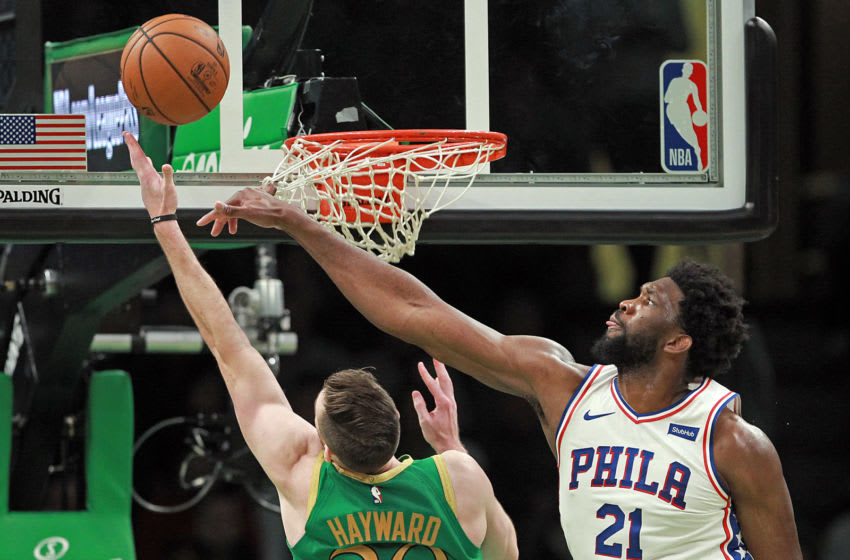 BOSTON, MA. - DECEMBER 12: Joel Embiid #21 of the Philadelphia 76ers keeps Gordon Hayward #20 of the Boston Celtics from scoring during the second half of the NBA game at the TD Garden on December 12, 2019 in Boston, Massachusetts. (Staff Photo By Matt Stone/MediaNews Group/Boston Herald)