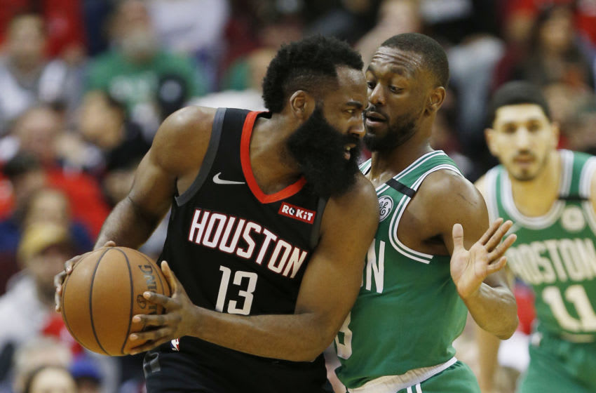 HOUSTON, TEXAS - FEBRUARY 11: James Harden #13 of the Houston Rockets is guarded by Kemba Walker #8 of the Boston Celtics at Toyota Center on February 11, 2020 in Houston, Texas. NOTE TO USER: User expressly acknowledges and agrees that, by downloading and/or using this photograph, user is consenting to the terms and conditions of the Getty Images License Agreement. (Photo by Bob Levey/Getty Images)