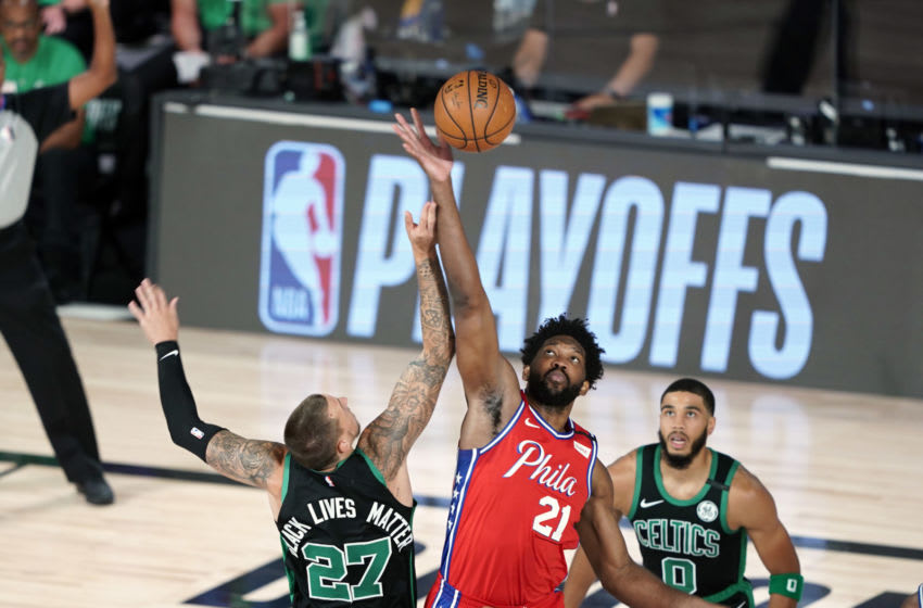 LAKE BUENA VISTA, FLORIDA - AUGUST 17: Joel Embiid #21 of the Philadelphia 76ers and Daniel Theis #27 of the Boston Celtics compete for the tip-off to start the first half at The Field House at ESPN Wide World Of Sports Complex on August 17, 2020 in Lake Buena Vista, Florida. NOTE TO USER: User expressly acknowledges and agrees that, by downloading and or using this photograph, User is consenting to the terms and conditions of the Getty Images License Agreement. (Photo by Ashley Landis - Pool/Getty Images)