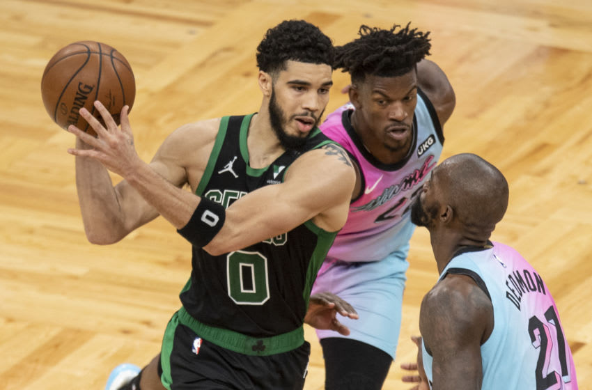 BOSTON, MASSACHUSETTS - MAY 09: Jayson Tatum #0 of the Boston Celtics drives to the basket while guarded by Jimmy Butler #22 of the Miami Heat during the second half at TD Garden on May 09, 2021 in Boston, Massachusetts. NOTE TO USER: User expressly acknowledges and agrees that, by downloading and or using this photograph, User is consenting to the terms and conditions of the Getty Images License Agreement. (Photo by Maddie Malhotra/Getty Images)