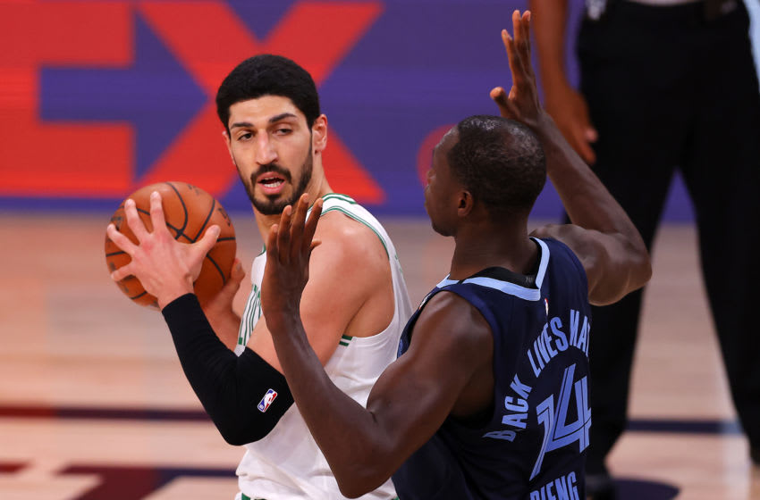 LAKE BUENA VISTA, FLORIDA - AUGUST 11: Enes Kanter #11 of the Boston Celtics drives the ball as Gorgui Dieng #14 of the Memphis Grizzlies defends during the fourth quarter at The Arena at ESPN Wide World Of Sports Complex on August 11, 2020 in Lake Buena Vista, Florida. NOTE TO USER: User expressly acknowledges and agrees that, by downloading and or using this photograph, User is consenting to the terms and conditions of the Getty Images License Agreement. (Photo by Mike Ehrmann/Getty Images)