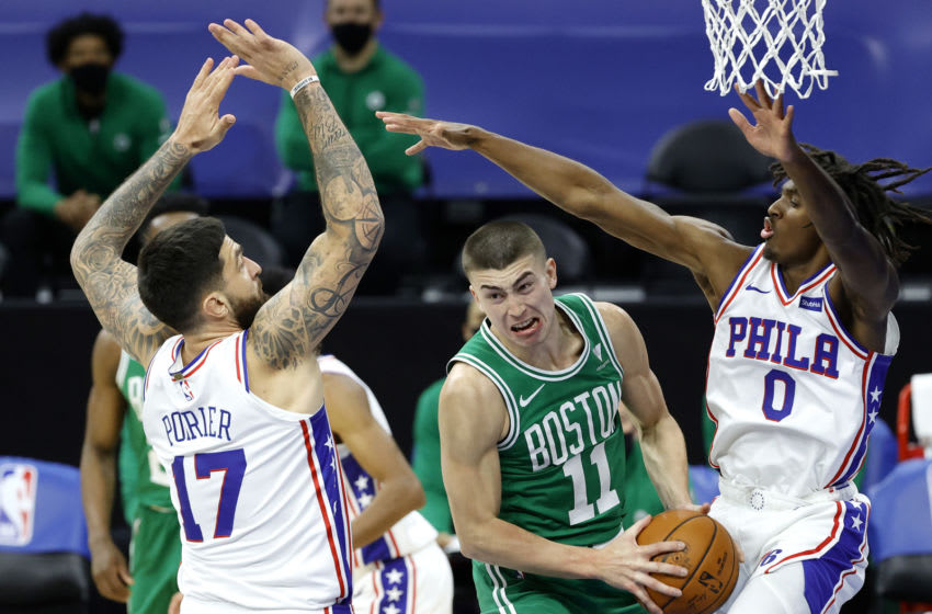 PHILADELPHIA, PENNSYLVANIA - DECEMBER 15: Payton Pritchard #11 of the Boston Celtics drives against the Philadelphia 76ers during the fourth quarter at Wells Fargo Center on December 15, 2020 in Philadelphia, Pennsylvania. NOTE TO USER: User expressly acknowledges and agrees that, by downloading and/or using this photograph, user is consenting to the terms and conditions of the Getty Images License Agreement. (Photo by Tim Nwachukwu/Getty Images)