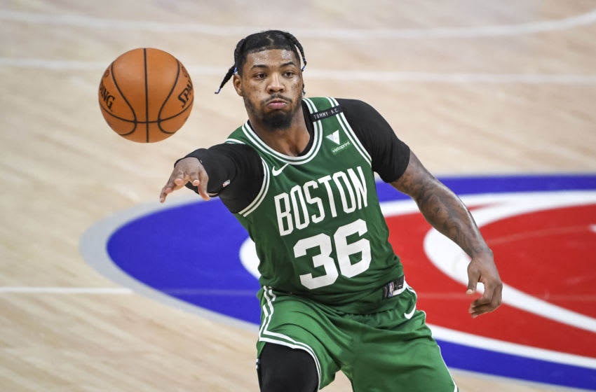 DETROIT, MICHIGAN - JANUARY 01: Marcus Smart #36 of the Boston Celtics passes the ball during the second half against the Detroit Pistons at Little Caesars Arena on January 01, 2021 in Detroit, Michigan. NOTE TO USER: User expressly acknowledges and agrees that, by downloading and or using this photograph, User is consenting to the terms and conditions of the Getty Images License Agreement. (Photo by Nic Antaya/Getty Images)