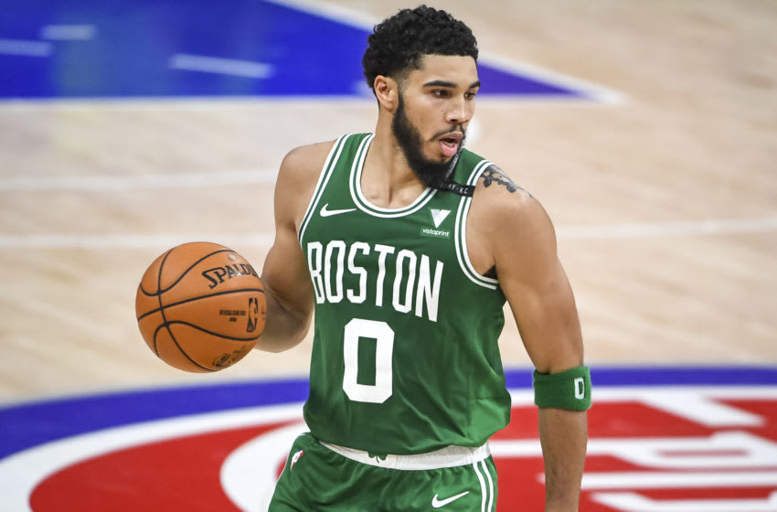 DETROIT, MICHIGAN - JANUARY 01: Jayson Tatum #0 of the Boston Celtics handles the ball during the second half against the Detroit Pistons at Little Caesars Arena on January 01, 2021 in Detroit, Michigan. NOTE TO USER: User expressly acknowledges and agrees that, by downloading and or using this photograph, User is consenting to the terms and conditions of the Getty Images License Agreement. (Photo by Nic Antaya/Getty Images)