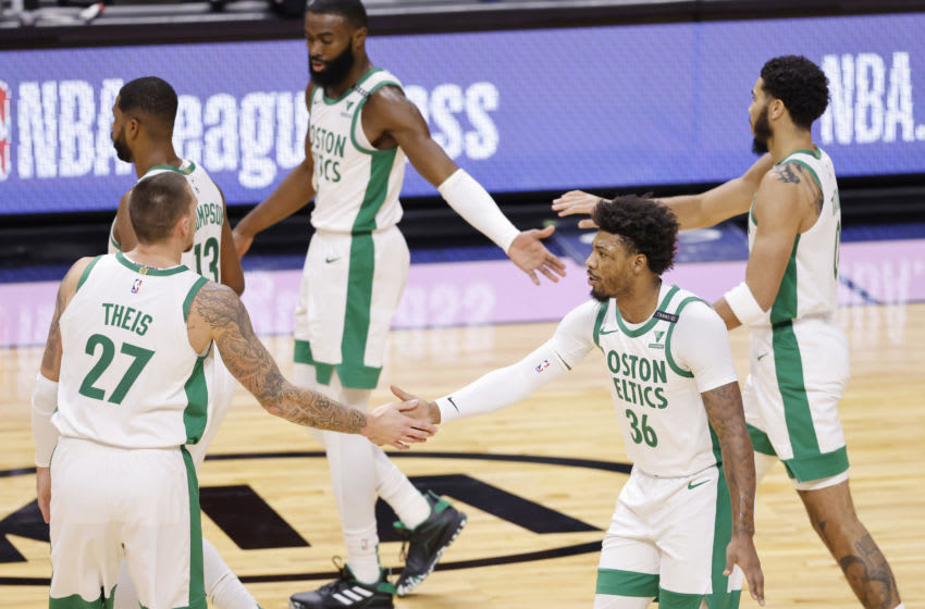 MIAMI, FLORIDA - JANUARY 06: Daniel Theis #27 of the Boston Celtics celebrates with Marcus Smart #36 after a basket against the Miami Heat during the first quarter at American Airlines Arena on January 06, 2021 in Miami, Florida. NOTE TO USER: User expressly acknowledges and agrees that, by downloading and or using this photograph, User is consenting to the terms and conditions of the Getty Images License Agreement. (Photo by Michael Reaves/Getty Images)