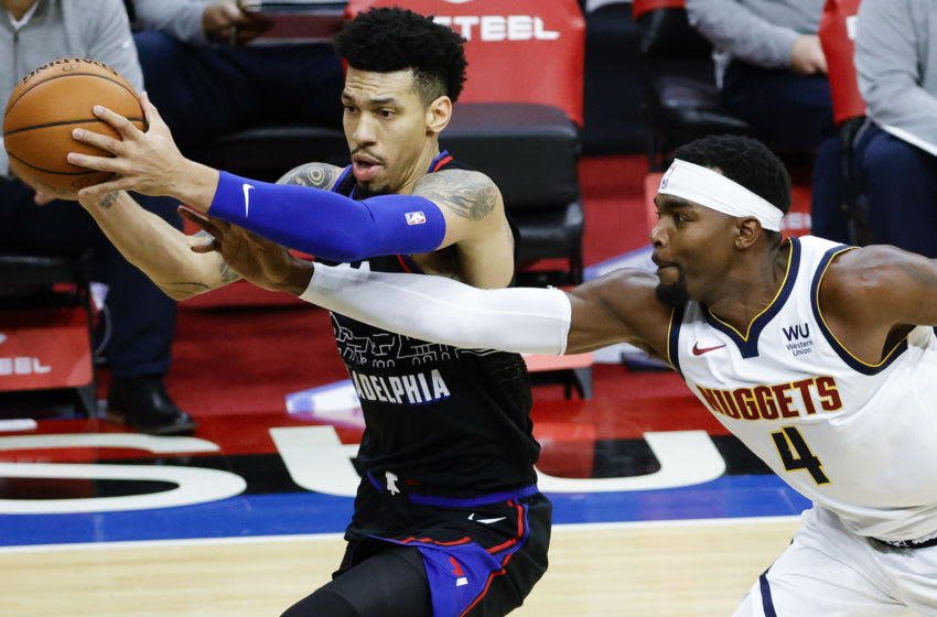 PHILADELPHIA, PENNSYLVANIA - JANUARY 09: Danny Green #14 of the Philadelphia 76ers drives past Paul Millsap #4 of the Denver Nuggets during the second quarter at Wells Fargo Center on January 09, 2021 in Philadelphia, Pennsylvania. NOTE TO USER: User expressly acknowledges and agrees that, by downloading and or using this photograph, User is consenting to the terms and conditions of the Getty Images License Agreement. (Photo by Tim Nwachukwu/Getty Images)