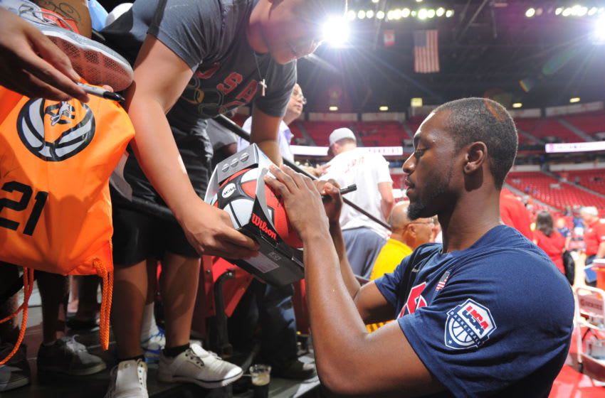 LAS VEGAS, NV - JULY 25: Kemba Walker #26 of the USA Blue Team signs a basketball prior to the start of the 2013 USA Basketball Showcase at the Thomas & Mack Center on July 25, 2013 in Las Vegas, Nevada. NOTE TO USER: User expressly acknowledges and agrees that, by downloading and/or using this Photograph, user is consenting to the terms and conditions of the Getty Images License Agreement. Mandatory Copyright Notice: Copyright 2013 NBAE (Photo by Andrew D. Bernstein/NBAE via Getty Images)