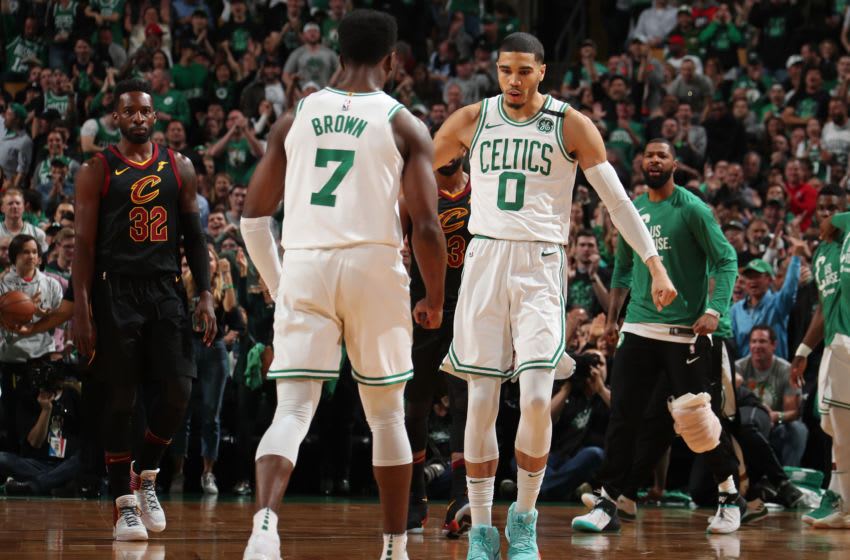 BOSTON, MA - MAY 27: Jaylen Brown #7 and Jayson Tatum #0 of the Boston Celtics exchange a handshake during Game Seven of the Eastern Conference Finals of the 2018 NBA Playoffs against the Cleveland Cavaliers on May 27, 2018 at the TD Garden in Boston, Massachusetts. NOTE TO USER: User expressly acknowledges and agrees that, by downloading and or using this photograph, User is consenting to the terms and conditions of the Getty Images License Agreement. Mandatory Copyright Notice: Copyright 2018 NBAE (Photo by Nathaniel S. Butler/NBAE via Getty Images)