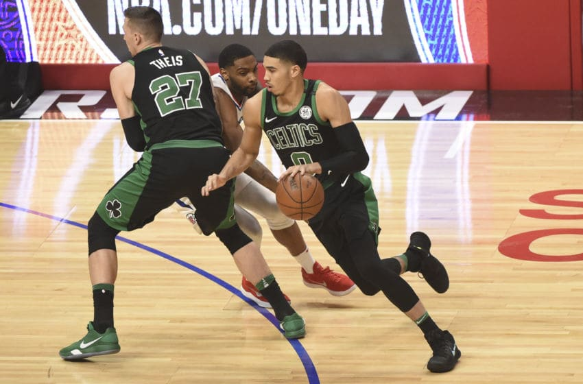 LOS ANGELES, CA - JANUARY 24: Jayson Tatum #0 of the Boston Celtics handles the ball against the LA Clippers on January 24, 2018 at STAPLES Center in Los Angeles, California. NOTE TO USER: User expressly acknowledges and agrees that, by downloading and/or using this Photograph, user is consenting to the terms and conditions of the Getty Images License Agreement. Mandatory Copyright Notice: Copyright 2018 NBAE (Photo by Adam Pantozzi/NBAE via Getty Images)