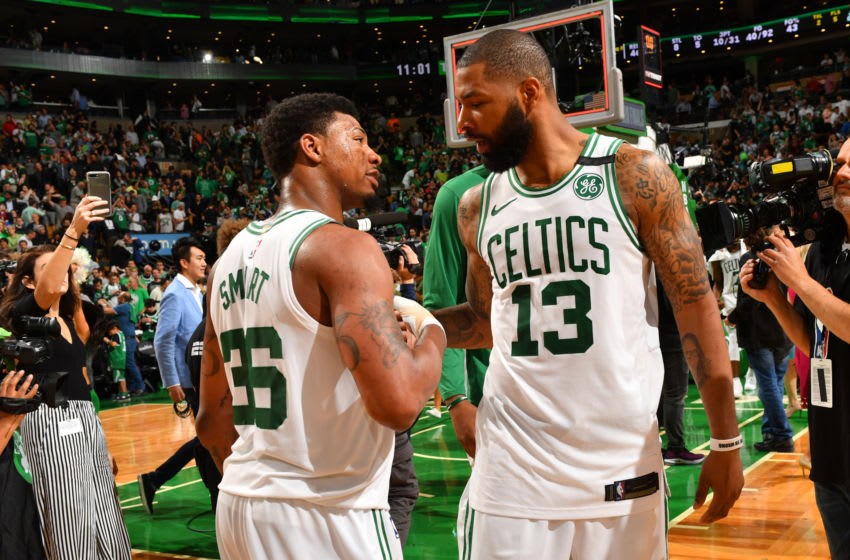 BOSTON, MA - MAY 15: Marcus Smart #36 and Marcus Morris #13 of the Boston Celtics exchange handshakes during Game Two of the Eastern Conference Finals against the Cleveland Cavaliers of the 2018 NBA Playoffs on May 15, 2018 at the TD Garden in Boston, Massachusetts. NOTE TO USER: User expressly acknowledges and agrees that, by downloading and or using this photograph, User is consenting to the terms and conditions of the Getty Images License Agreement. Mandatory Copyright Notice: Copyright 2018 NBAE (Photo by Jesse D. Garrabrant/NBAE via Getty Images)