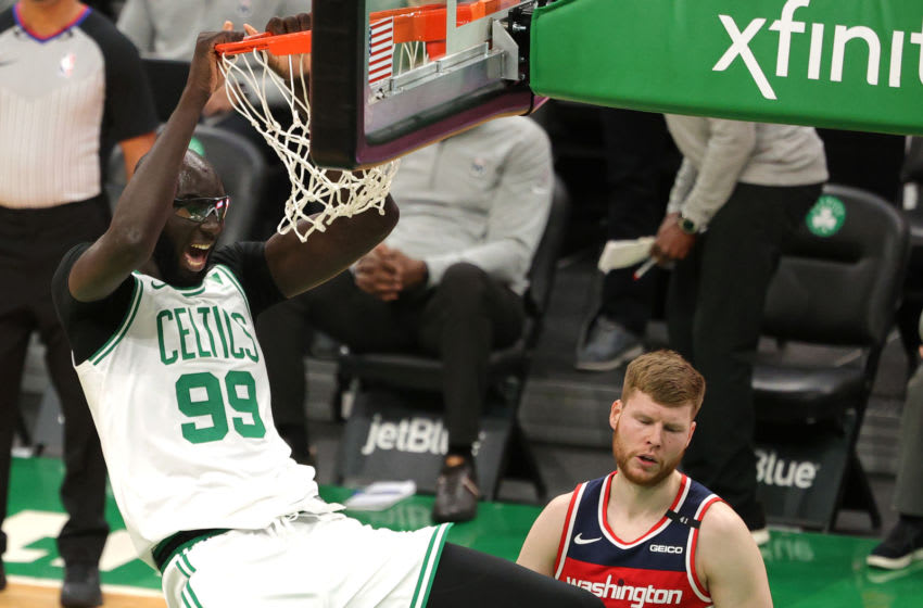BOSTON, MASSACHUSETTS - JANUARY 08: Tacko Fall #99 of the Boston Celtics dunks against the Washington Wizards in the fourth quarter at TD Garden on January 08, 2021 in Boston, Massachusetts. The Celtics defeat the Wizards 116-107. NOTE TO USER: User expressly acknowledges and agrees that, by downloading and or using this photograph, User is consenting to the terms and conditions of the Getty Images License Agreement. (Photo by Maddie Meyer/Getty Images)