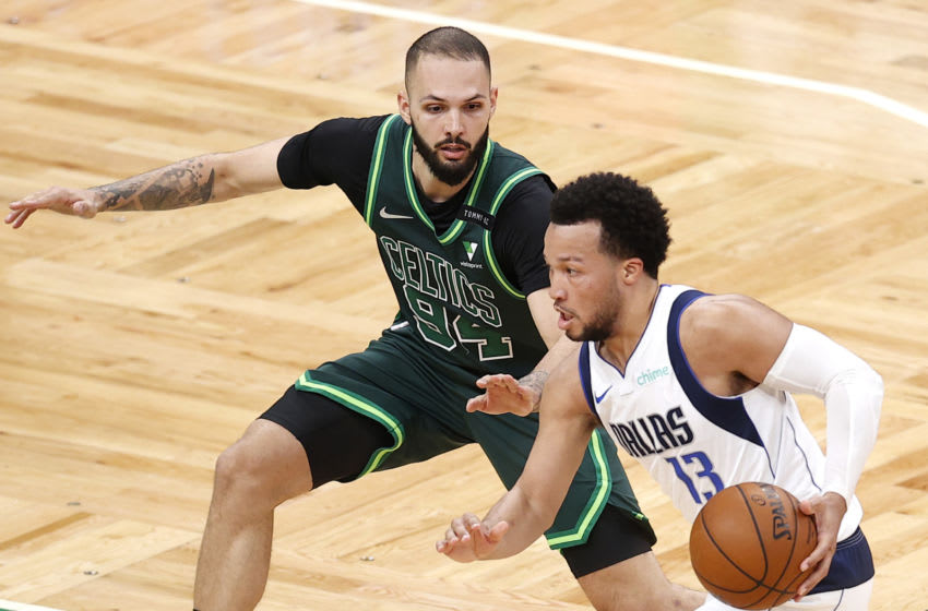 BOSTON, MASSACHUSETTS - MARCH 31: Jalen Brunson #13 of the Dallas Mavericks drives against Evan Fournier #94 of the Boston Celtics at TD Garden on March 31, 2021 in Boston, Massachusetts. The Mavericks defeat the Celtics 113-108. (Photo by Maddie Meyer/Getty Images)