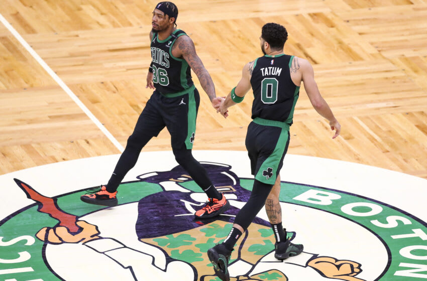 BOSTON, MA - MAY 28: Jayson Tatum #0 reacts with Marcus Smart #36 of the Boston Celtics during Game Three of the Eastern Conference first round series against the Brooklyn Nets at TD Garden on May 28, 2021 in Boston, Massachusetts. NOTE TO USER: User expressly acknowledges and agrees that, by downloading and or using this photograph, User is consenting to the terms and conditions of the Getty Images License Agreement. (Photo by Adam Glanzman/Getty Images)