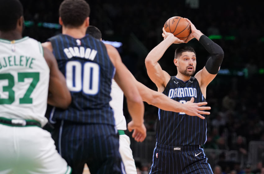 Feb 5, 2020; Boston, Massachusetts, USA; Orlando Magic center Nikola Vucevic (9) looks to pass against the Boston Celtics in the second quarter at TD Garden. Mandatory Credit: David Butler II-USA TODAY Sports