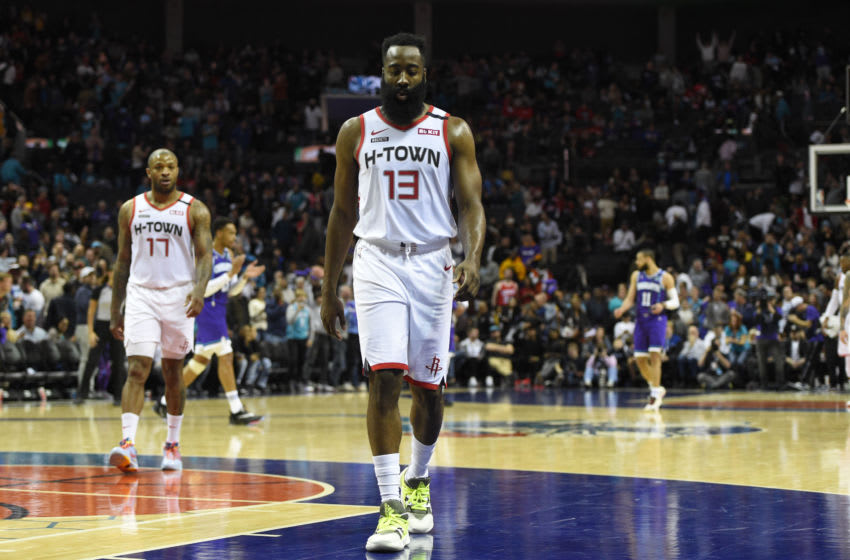 Mar 7, 2020; Charlotte, North Carolina, USA; Houston Rockets guard James Harden (13) and forward P.J. Tucker (17) walk off the court at the end of the game at Spectrum Center. Mandatory Credit: Bob Donnan-USA TODAY Sports
