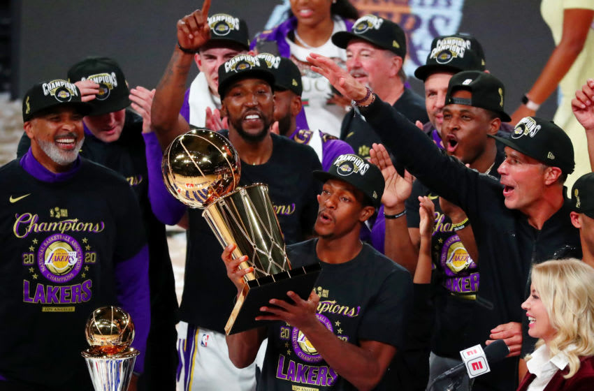 Oct 11, 2020; Lake Buena Vista, Florida, USA; Los Angeles Lakers guard Rajon Rondo (9) holds the trophy as he celebrates with teammates after game six of the 2020 NBA Finals at AdventHealth Arena. The Los Angeles Lakers won 106-93 to win the series. Mandatory Credit: Kim Klement-USA TODAY Sports