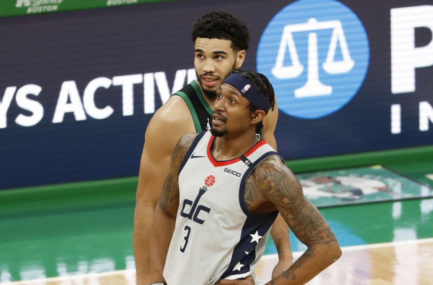 Feb 28, 2021; Boston, Massachusetts, USA; Boston Celtics forward Jayson Tatum (0) talks with Washington Wizards guard Bradley Beal (3) during the second quarter at TD Garden. Mandatory Credit: Winslow Townson-USA TODAY Sports