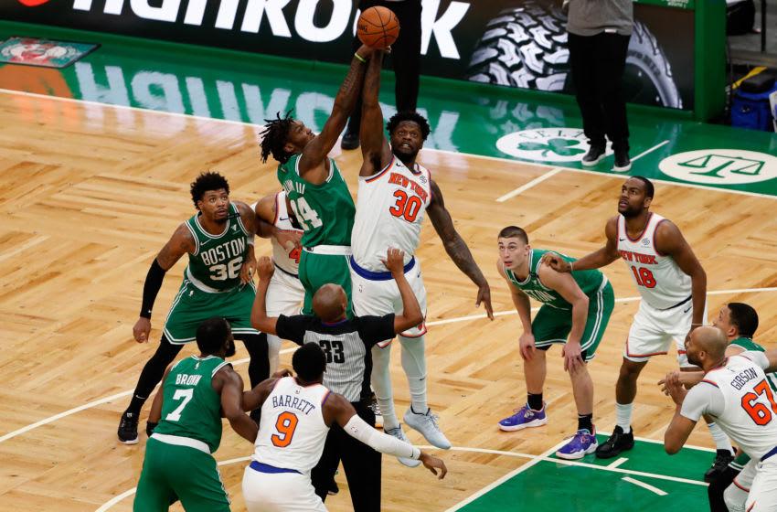 Apr 7, 2021; Boston, Massachusetts, USA; New York Knicks forward Julius Randle (30) jumps against Boston Celtics center Robert Williams III (44) during the third quarter at TD Garden. Mandatory Credit: Winslow Townson-USA TODAY Sports