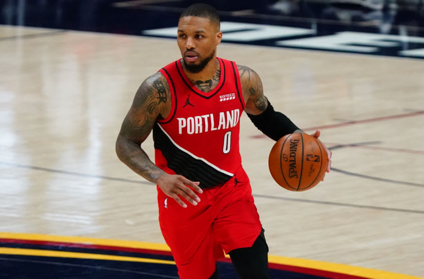 May 22, 2021; Denver, Colorado, USA; Portland Trail Blazers guard Damian Lillard (0) controls the ball against the Denver Nuggets during the third quarter during game one in the first round of the 2021 NBA Playoffs at Ball Arena. Mandatory Credit: Ron Chenoy-USA TODAY Sports