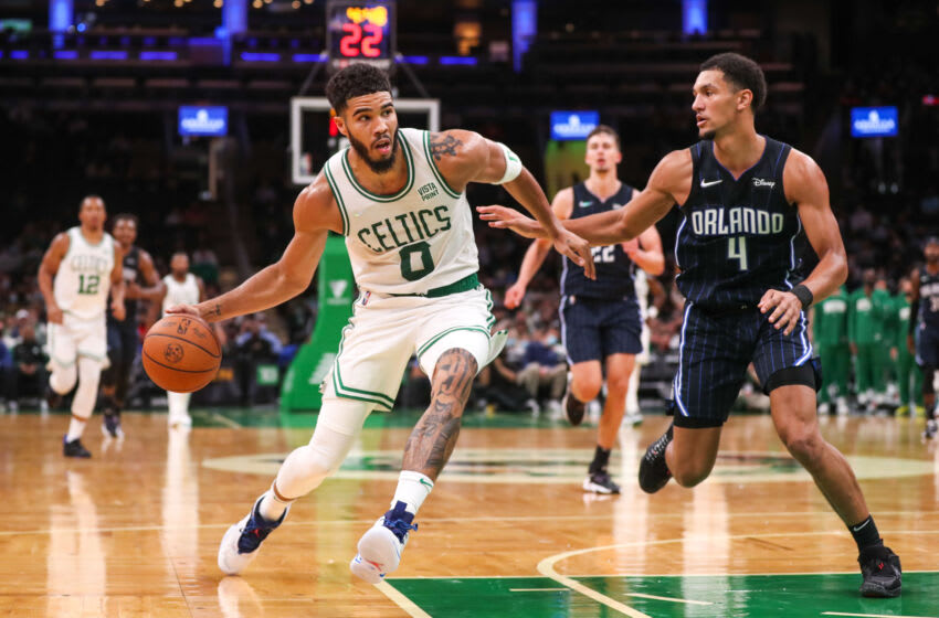 Oct 4, 2021; Boston, Massachusetts, USA; Boston Celtics forward Jayson Tatum (0) drives to the basket defended by Orlando Magic guard Jalen Suggs (4) during the second half at TD Garden. Mandatory Credit: Paul Rutherford-USA TODAY Sports