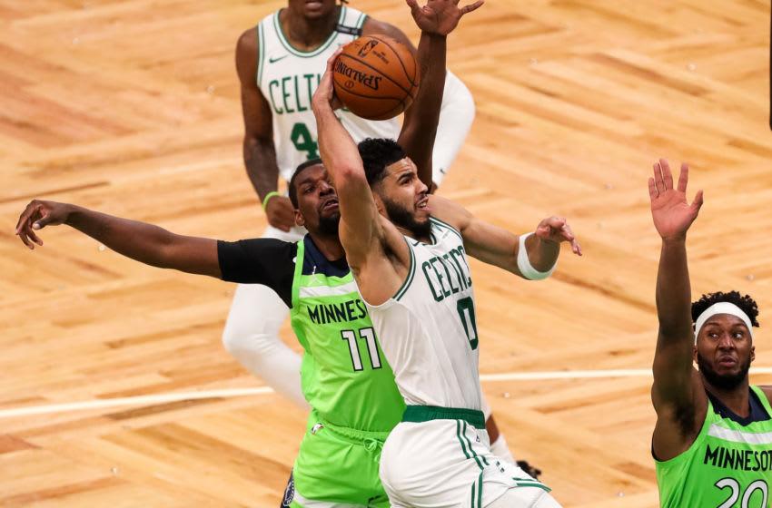 Apr 9, 2021; Boston, Massachusetts, USA; Boston Celtics forward Jayson Tatum (0) shoots during the second half defended by Minnesota Timberwolves center Naz Reid (11) at TD Garden. Mandatory Credit: Paul Rutherford-USA TODAY Sports