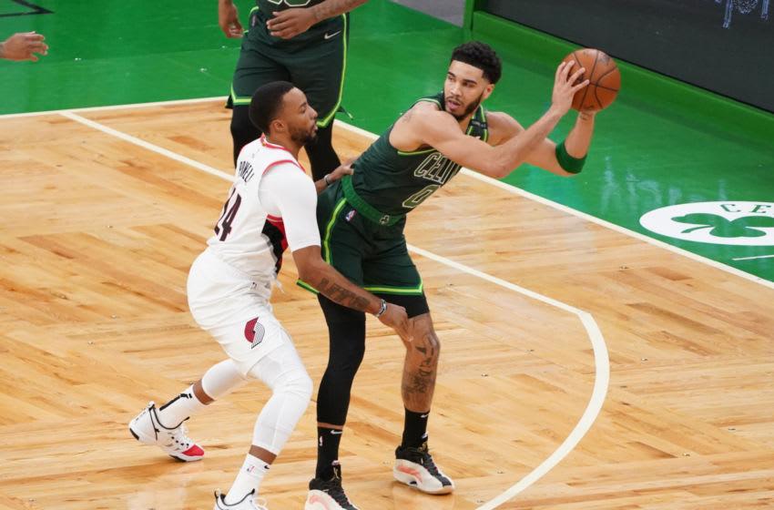 May 2, 2021; Boston, Massachusetts, USA; Boston Celtics forward Jayson Tatum (0) works the ball against Portland Trail Blazers forward Norman Powell (24) in the fist quarter at TD Garden. Mandatory Credit: David Butler II-USA TODAY Sports