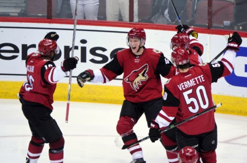 Mar 5, 2016; Glendale, AZ, USA; Arizona Coyotes left wing Alex Tanguay (40) celebrates with center Antoine Vermette (50), and defenseman Connor Murphy (5) after scoring a goal in the second period against the Florida Panthers at Gila River Arena. Mandatory Credit: Matt Kartozian-USA TODAY Sports