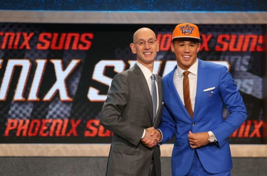 Jun 25, 2015; Brooklyn, NY, USA; Devin Booker (Kentucky) greets NBA commissioner Adam Silver after being selected as the number thirteen overall pick to the Phoenix Suns in the first round of the 2015 NBA Draft at Barclays Center. Mandatory Credit: Brad Penner-USA TODAY Sports