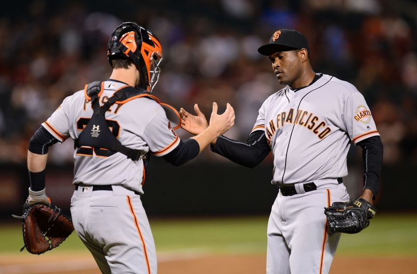 May 13, 2016; Phoenix, AZ, USA; San Francisco Giants relief pitcher Santiago Casilla (46) celebrates with catcher Buster Posey (28) after defeating the Arizona Diamondbacks 3-1 at Chase Field. Mandatory Credit: Joe Camporeale-USA TODAY Sports