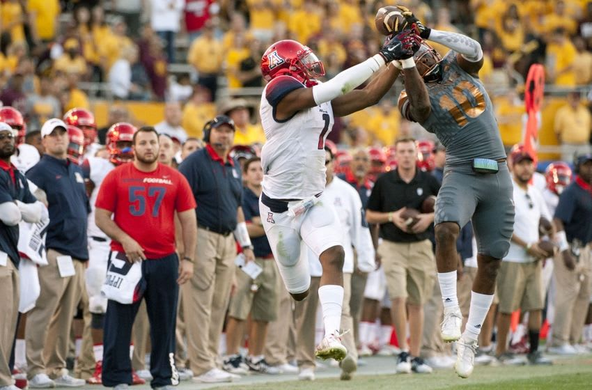 Nov 21, 2015; Tempe, AZ, USA; Arizona Wildcats wide receiver Cayleb Jones (1) attempts to catch the ball against Arizona State Sun Devils defensive back Kweishi Brown (10) during the fourth quarter of the territorial cup at Sun Devil Stadium. The Sun Devils won 52-37. Mandatory Credit: Casey Sapio-USA TODAY Sports