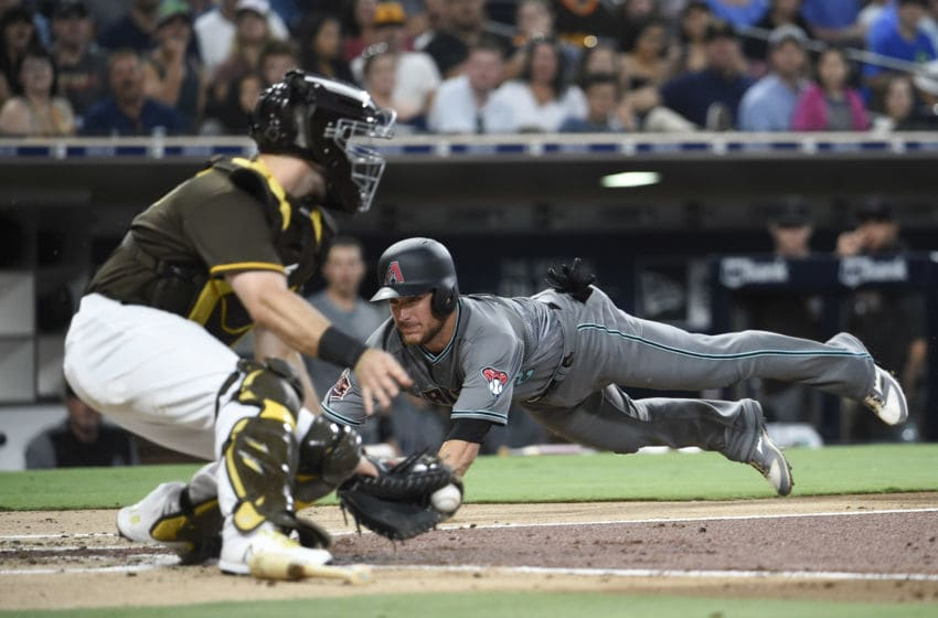SAN DIEGO, CA - JULY 27: Jeff Mathis #2 of the Arizona Diamondbacks scores ahead of the tag of Austin Hedges #18 of the San Diego Padres during the third inning of a baseball game PETCO Park on July 27, 2018 in San Diego, California. (Photo by Denis Poroy/Getty Images)
