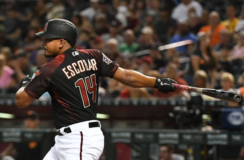 PHOENIX, AZ - AUGUST 03: Eduardo Escobar #14 of the Arizona Diamondbacks hits an RBI single in the first inning of the MLB game against the San Francisco Giants at Chase Field on August 3, 2018 in Phoenix, Arizona. (Photo by Jennifer Stewart/Getty Images)
