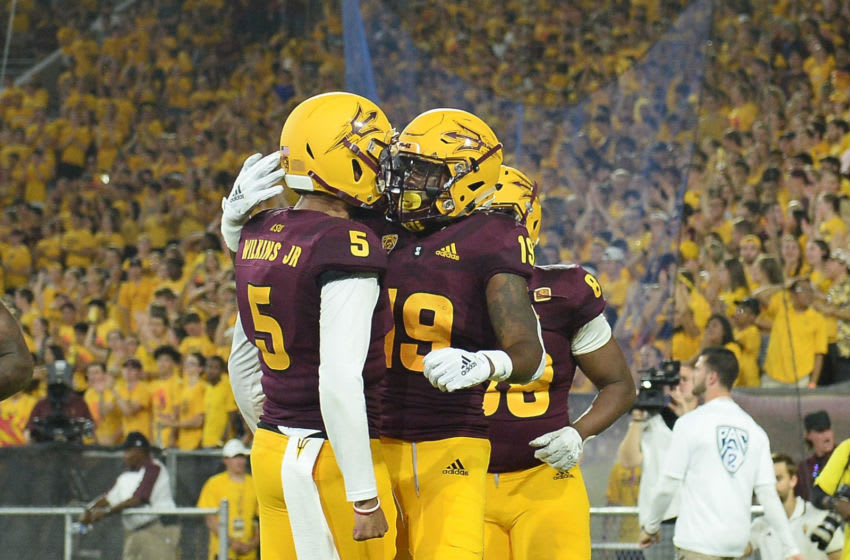 TEMPE, AZ - SEPTEMBER 01: Wide receiver Terrell Chatman #19 of the Arizona State Sun Devils celebrates an 11 yard touchdown with quarterback Manny Wilkins #5 in the first half against the UTSA Roadrunners at Sun Devil Stadium on September 1, 2018 in Tempe, Arizona. (Photo by Jennifer Stewart/Getty Images)